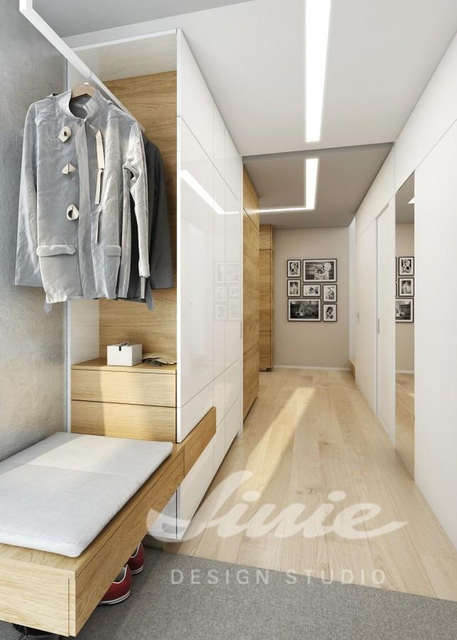 Moderní předsíň s úložnými prostory v bílé barvě