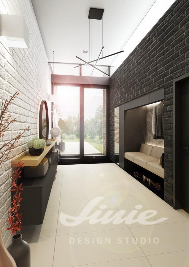Moderní hala s motivem černých a bílých cihel
