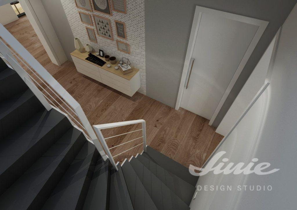 Moderní hala s černým schodištěm a bílým zábradlím