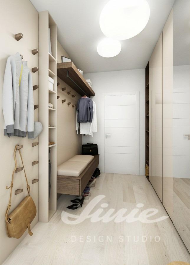 Moderní předsíň zařízená v krémové barvě s podlahou ze světlého dřeva
