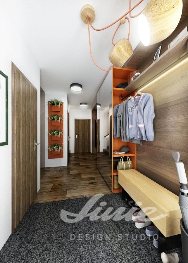 Moderní předsíň s podlahou z tmavého dřeva