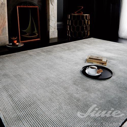 kusový béžový koberec bez vzoru