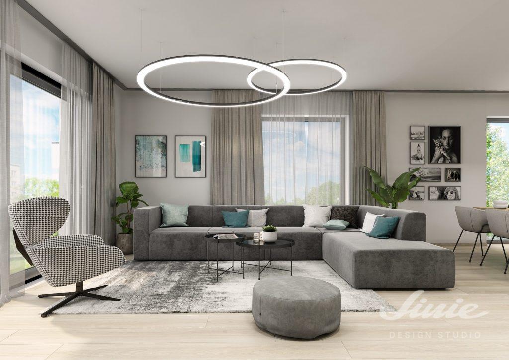 Design obývacího pokoje šedá sedací souprava a tyrkysové detaily