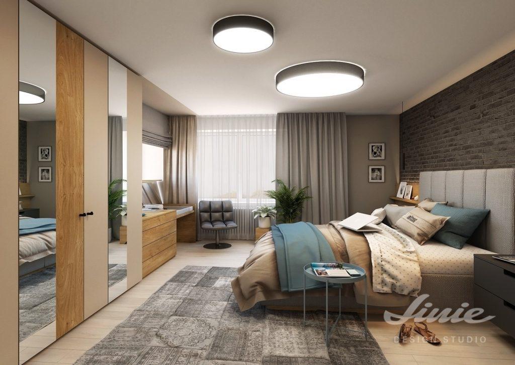 Design ložnice v tmavých barvách s modrými detaily